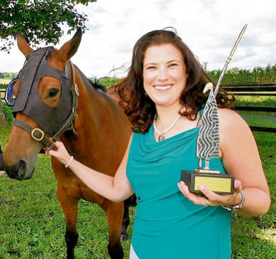 Dr. Barbara Murphy demonstrates new invention, the Equilume: image via irishtimes.com