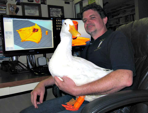 Buttercup & Mike Carey of Feathered Angels Waterfowl Sanctuary in Arlington, TN: Buttercup received a 3D printed prosthetic (Image via Facebook)