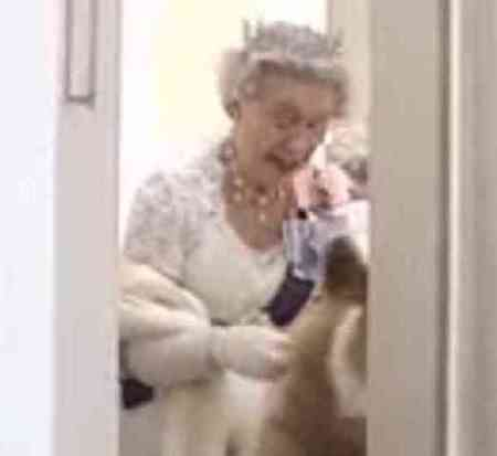 Queen Elizabeth and one of her corgis in an unguarded moment. (You Tube Image)