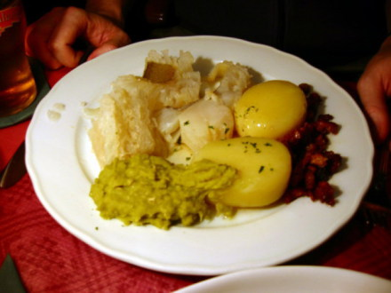 Lutefisk Dinner with Potatoes, Baco, and Green Pea Stew (Public Domain Image)