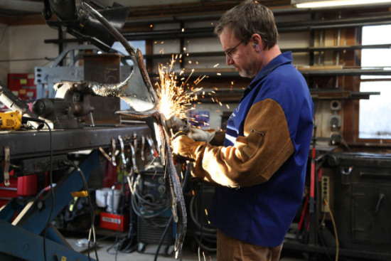 Williams Process Part Three: Chris Williams shown here, grinding smooth a piece of the sculpture.