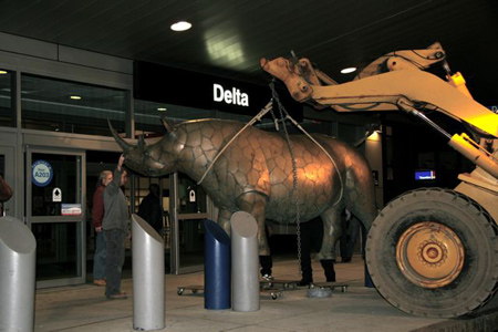 Installing Bronze Rhino by Williams: This bronze rhino sculpture was on display in front of the Delta terminal at Boston's Logan Airport.