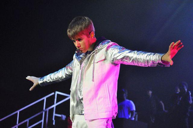 Justin Bieber performing at a 2011 concert. Photo by Adam Sundana.