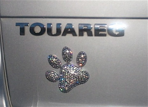 Dress up your drive in style with rhinestone dog paw emblem