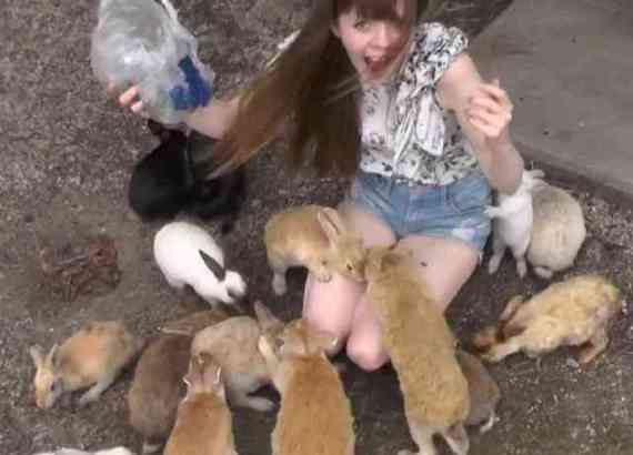 Mira, a Tokyo Resident, with the Rabbits (You Tube Image)