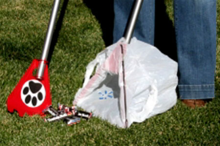 YardPup & Paw™ cleans up the dog poop and the Tootsie Rolls: ©She-Edison, LLC