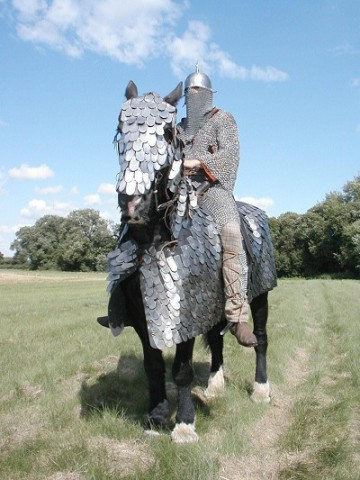 Horse in armor with knight in chain maille (Photo by John Treelling/Creative Commons via Wikimedia)