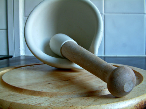 Mortar and pestle for grinding clay into dust