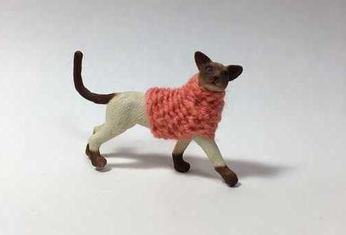 Esoteric Artist Knits Tiny Sweaters For Plastic Animals