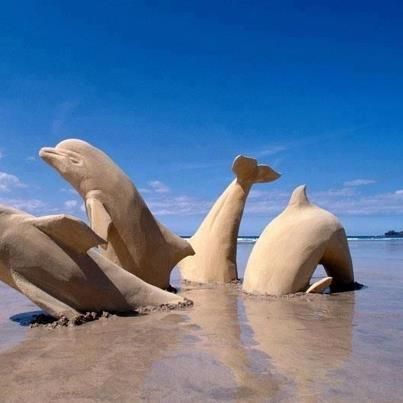 Gamboling Dolphins Sand Sculpture