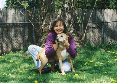 Deborah Pointer, animal communicator, and her dog Cinnamon: image via animalove.org