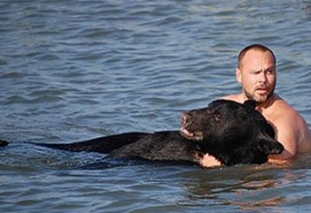 Man Saves Bear In Wildlife Reversal