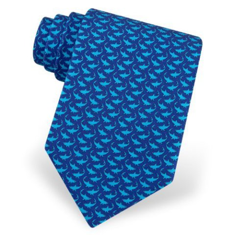 Turquoise sharks on a navy blue backgroud makes this tie a classic