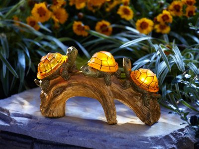 Turtle solar powered outdoor light petslady add some light and whimsy to your lawn or garden with this turtle solar powered light three adorable turtles with led lit shells rest on a poly resin log aloadofball Choice Image
