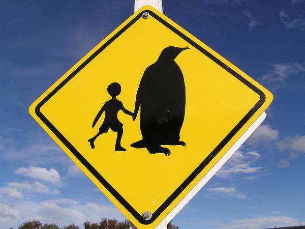 Weird Penguin & Child Road Crossing Sign