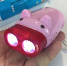 Rechargeable Hand-Pressure LED Piggy Flashlight Hogs The Spotlight